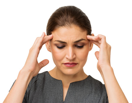 Mid adult businesswoman suffering from headache isolated over white background. Horizontal shot. Stock Photo