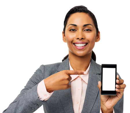 Portrait of happy businesswoman pointing at smart phone isolated over white background. Horizontal shot. photo