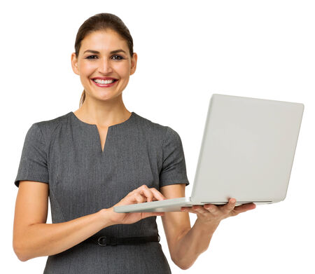 Portrait of confident mid adult businesswoman with laptop isolated over white background. Horizontal shot. photo