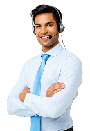 up service: Portrait of confident male customer service representative wearing headset over white background. Vertical shot. Stock Photo
