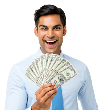Portrait of excited businessman holding fanned out fifty dollar notes against white background. Horizontal shot. photo