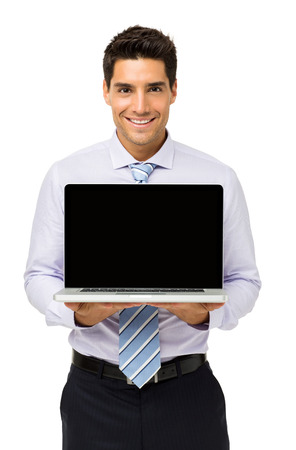 Portrait of happy businessman promoting laptop isolated over white background. Vertical shot. Stock Photo