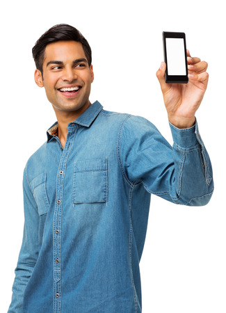 self communication: Happy young man taking self portrait photography through smart phone over white background. Vertical shot.
