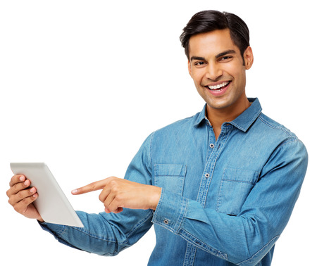 Portrait of smiling young man using digital tablet over white background. Horizontal shot. photo