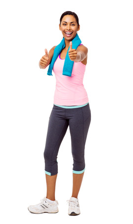 Full length portrait of happy young woman gesturing thumbs up over white background. Vertical shot. Stock Photo - 27411954