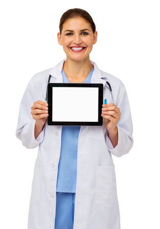 Portrait of confident female doctor showing digital tablet against white background. Vertical shot. photo