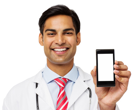 Portrait of smiling male doctor showing smart phone over white background. Horizontal shot. photo