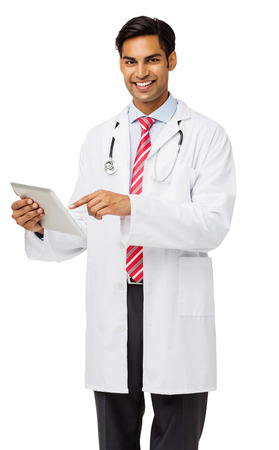 Portrait of confident male doctor holding tablet computer against white background. Vertical shot. Stock Photo