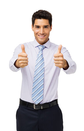 Portrait of confident businessman showing thumbs up against white background. Vertical shot. photo