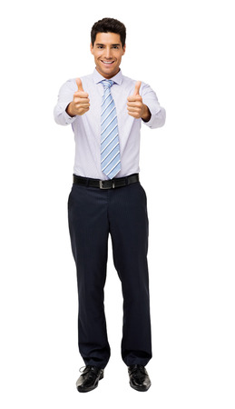 Portrait of smiling businessman gesturing thumbs up against white background. Vertical shot. photo