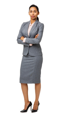 Full length portrait of confident businesswoman with arms crossed isolated over white background. Vertical shot. photo