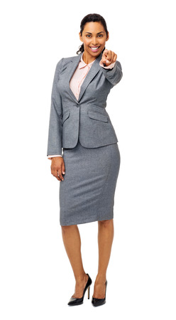 Full length portrait of confident businesswoman pointing at you isolated over white background. Vertical shot. photo