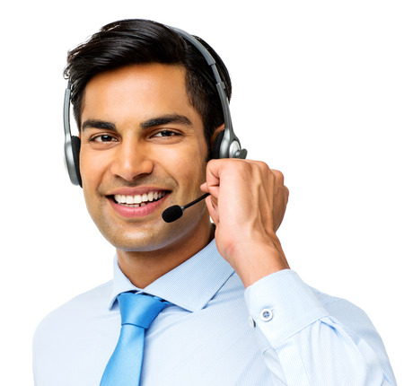 call out: Portrait of smiling male call center representative wearing headset over white background. Horizontal shot.