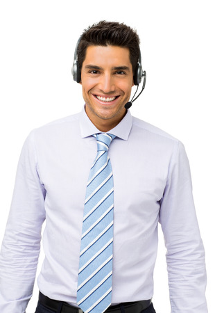 Portrait of confident customer service representative standing isolated over white background. Vertical shot. Stock Photo