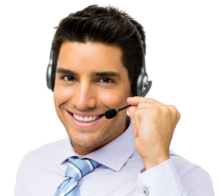 Portrait of smiling male call center representative talking on headset over white background. Horizontal shot. Stock Photo