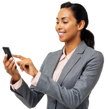 Beautiful young businesswoman text messaging on smart phone over white background. Horizontal shot. photo