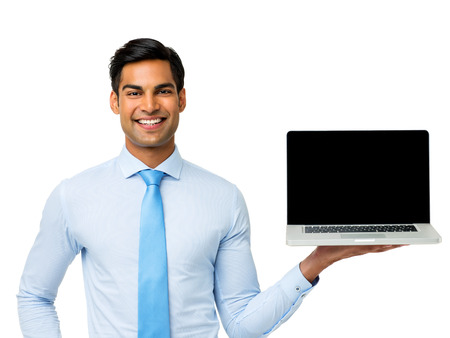 Portrait of happy businessman holding laptop over white background. Horizontal shot.