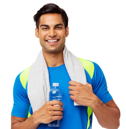 Portrait of confident fit man with towel and water bottle against white background. Horizontal shot.