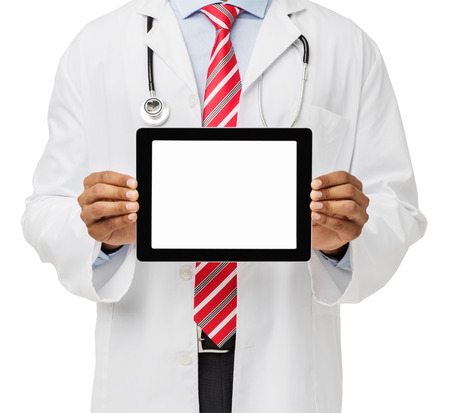 Midsection of male doctor advertising digital tablet against white background. Horizontal shot.