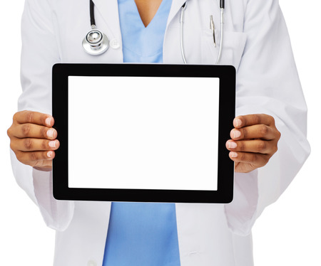 Midsection of female doctor showing digital tablet against white background. Horizontal shot. photo