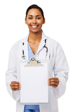 Portrait of confident female doctor showing blank paper on clipboard against white background. Vertical shot. photo