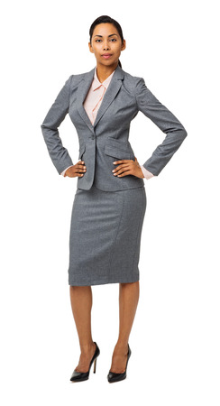 Full length portrait of confident well-dressed businesswoman with hands on hips isolated over white background. Vertical shot. photo