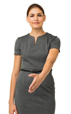 Portrait of confident businesswoman offering handshake against white background. Vertical shot. photo