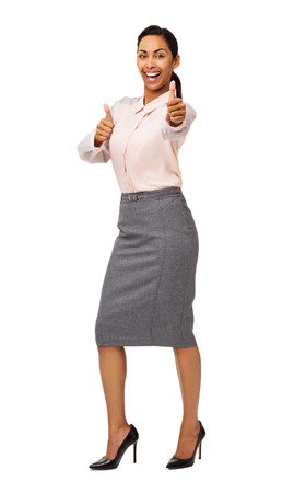 Full length portrait of cheerful businesswoman gesturing thumbs up isolated over white background. Vertical shot. photo
