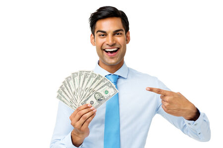 Portrait of happy young businessman showing fanned out fifty dollar notes over white background. Horizontal shot. photo