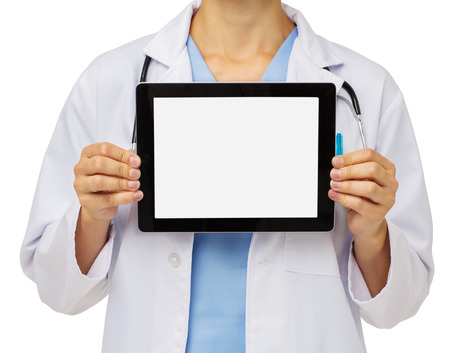Midsection of mid adult female doctor showing digital tablet over white background. Horizontal shot. photo