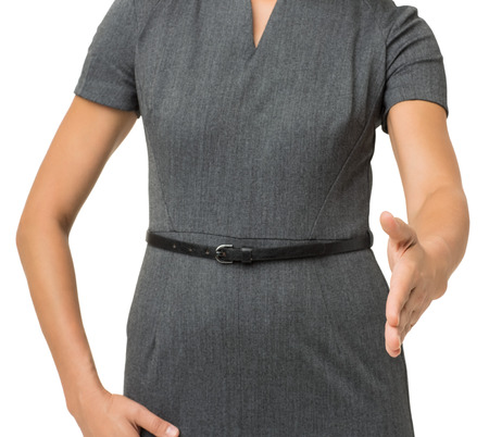 handed: Midsection of businesswoman gesturing handshake isolated over white background. Horizontal shot.