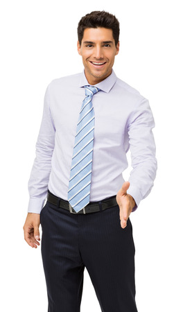 Portrait of happy young businessman offering handshake against white background. Vertical shot. photo