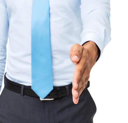 left handed: Midsection of businessman offering handshake against white background. Horizontal shot.