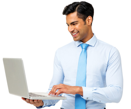 Young businessman using laptop against white background. Horizontal shot.