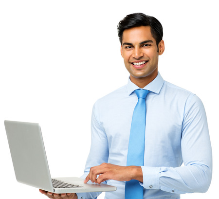 Portrait of confident businessman using laptop over white background. Horizontal shot. Stock Photo