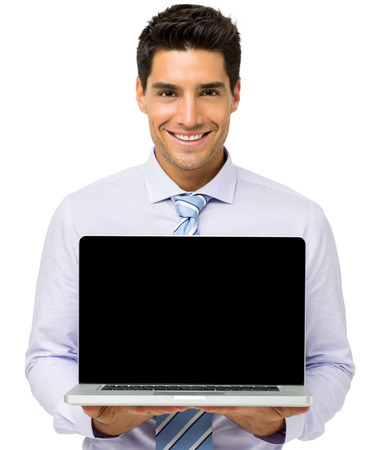 Portrait of confident businessman advertising laptop against white background. Horizontal shot.