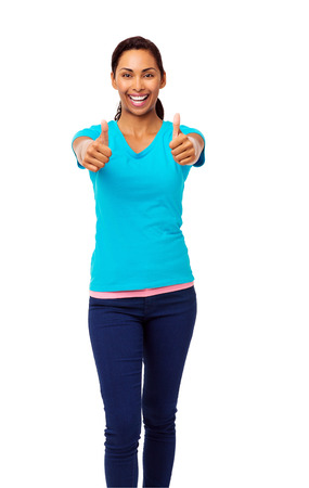 Portrait of happy Asian woman gesturing thumbs up over white background. Vertical shot.