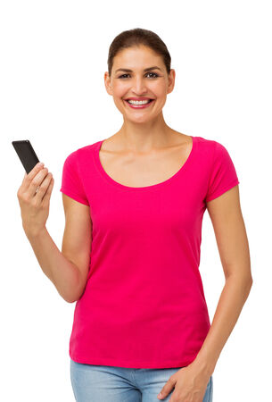 Portrait of happy woman holding smart phone over white background. Vertical shot.