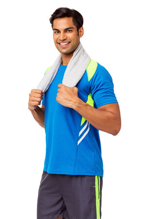 Portrait of happy young man with towel around neck standing over white background. Vertical shot. photo