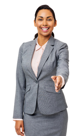 left handed: Portrait of happy young businesswoman offering handshake against white background. Vertical shot. Stock Photo