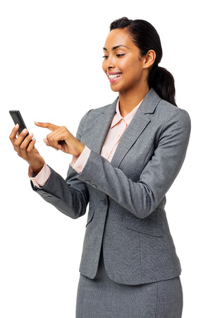 Happy businesswoman reading text message on smart phone over white background. Vertical shot. photo