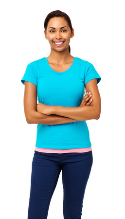 Portrait of smiling young woman in casuals standing arms crossed over white background. Vertical shot. photo