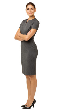 Full length portrait of confident businesswoman with arms crossed over white background. Vertical shot.