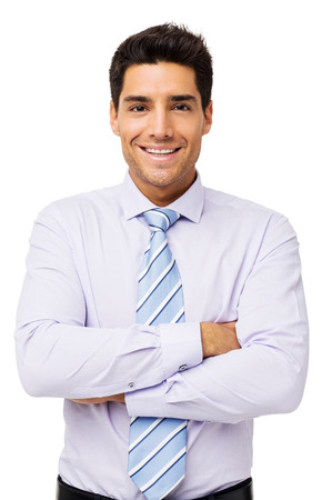 businessman standing: Portrait of happy businessman standing arms crossed over white background. Vertical shot. Stock Photo