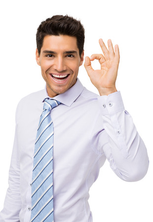 Portrait of happy businessman gesturing okay isolated over white background. Vertical shot. photo