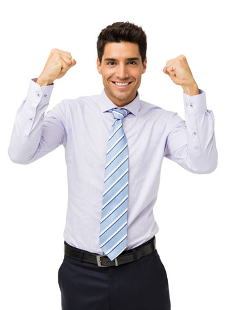 Portrait of smiling businessman gesturing success over white background. Vertical shot. photo