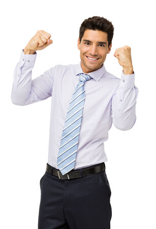Portrait of successful businessman with clenched fist isolated over white background. Vertical shot. photo