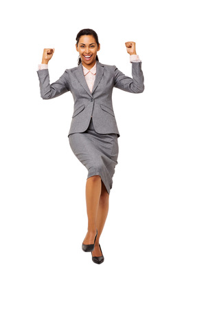Full length portrait of excited young businesswoman celebrating success against white background. Vertical shot.
