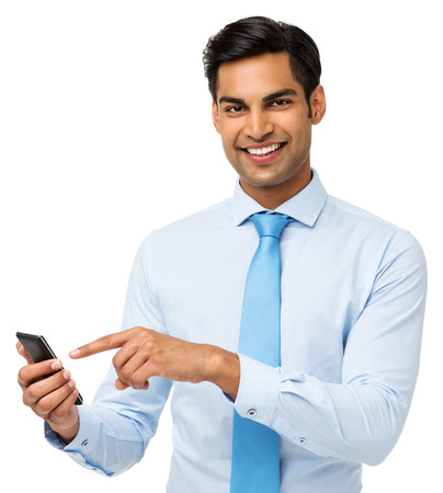 Portrait of smiling young businessman touching smart phone isolated over white background. Horizontal shot. photo