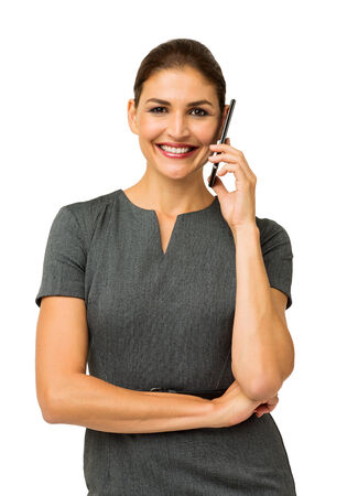 Portrait of happy businesswoman answering smart phone against white background. Vertical shot.